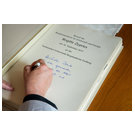 Federal Minister for Economics Brigitte Zypries signs the roll of honour
