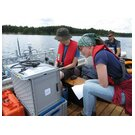 Lisa Jarosch and Gero Licht view the measurement data on the boat.