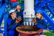 three Doctoral candidates with the new electro-impulse drilling head