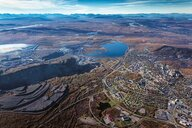 Aerial view of Kiruna with the city and former open-pit mines