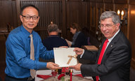 The vice-president of USST Ping Liu presents a gift to the Rector