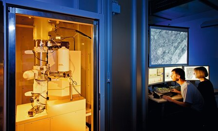 Researchers investigating a sample of the hard coating