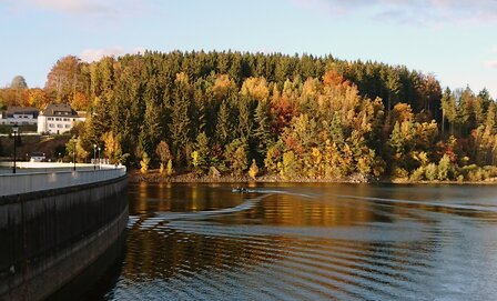 View of the Saidenbach drinking water dam with a boat of the science divers
