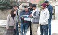 A group of international students looking at a plan