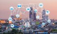 Internet of Things and Smart city concept. Smart things icons mesh on cityscape