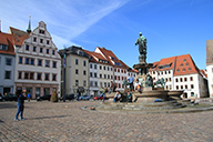 The Obermarkt in the centre of the town Freiberg with a statue of a knight